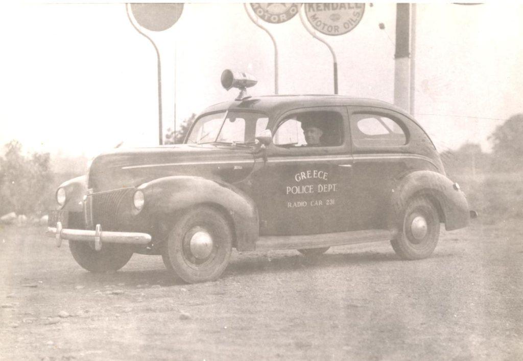 Officer William Gray in Greece Police Department Radio Patrol Car