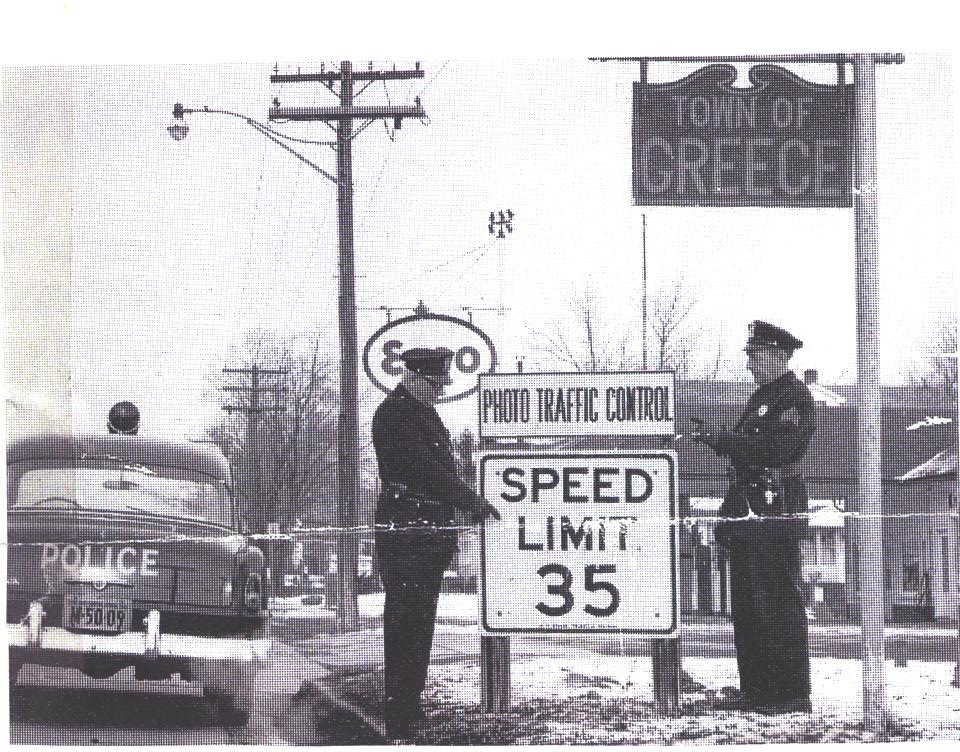 Chief Milton Carter and Officer Gray Posting Traffic Control Device