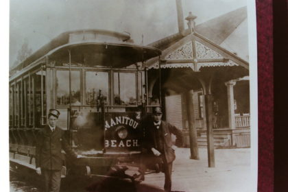 Conductors in Front of Manitou Beach Trolley