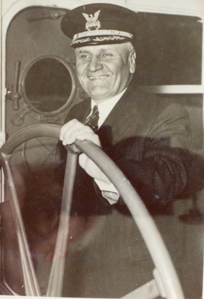 John H. Odenbach at the Helm
