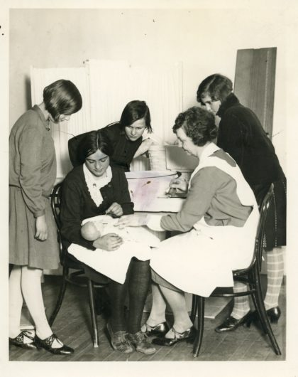 Little Mothers' League Members Receiving Child Care Instruction