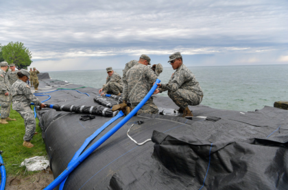 U.S. Army Soldiers Placing Inflatable Dam Along Lake Ontario